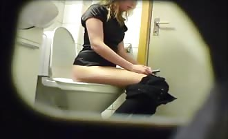 Spying on a blonde girl pooping
