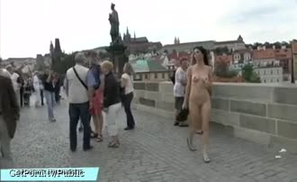 Two girls naked in the public square