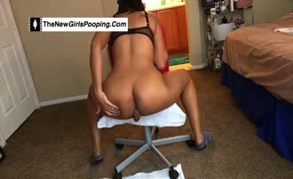 She's pooping from a chair