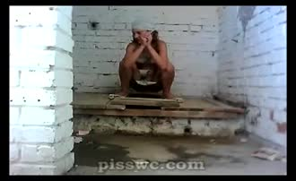 Girl in a bathing piss and pooping