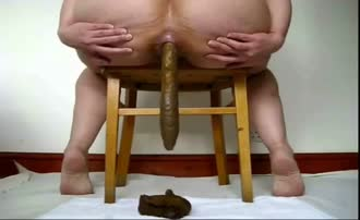 Big turd from wooden chair
