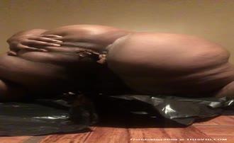 Ebony girl shitting on her knees