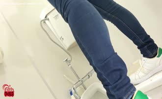 Brown haired babe using public bathroom